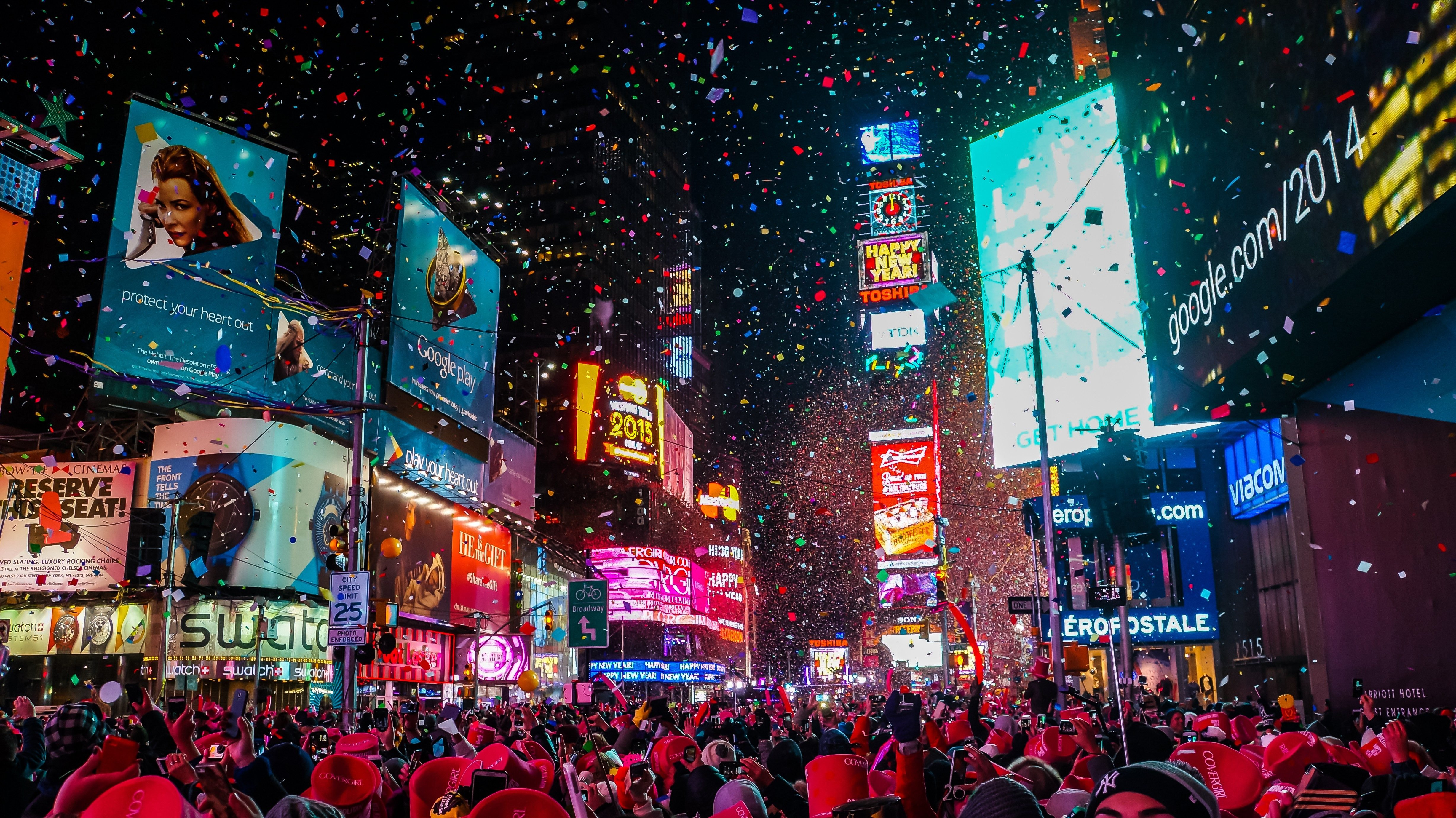 New York City, USA, January 1, 2015, Atmospheric new year's eve celebration on famous times square intersection after midnight with countless happy people enjoying the party; Shutterstock ID 1418089289; Job (TFH, TOH, RD, BNB, CWM, CM): RD
