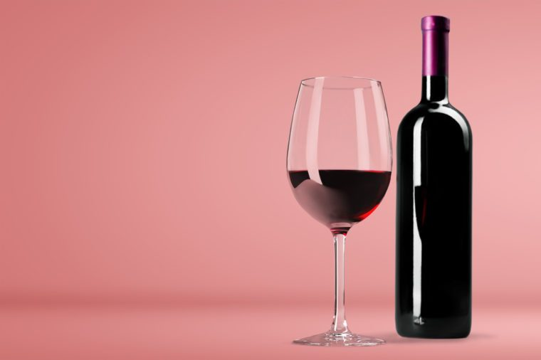 Red Wine in Bottle and Glass on white background