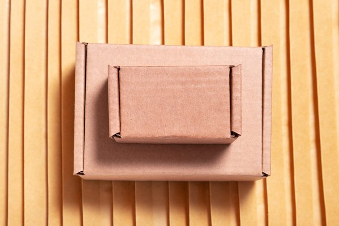 Brown cardboard box on lot of bubble envelopes