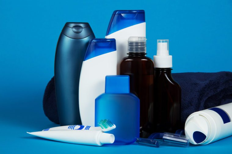Set of different men's cosmetics on a blue background