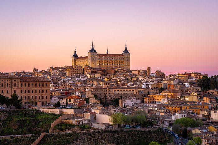 Panoramic view of Toledo with Alcazar castle at sunset, Castilla-La Mancha, Spain