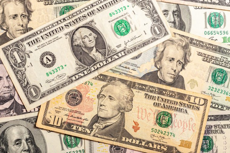 Close-up of multiple American dollar banknotes.