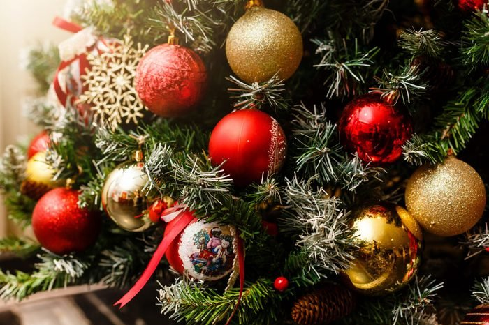 Christmas concept, lovely decorated Christmas tree, red glitter ball close up