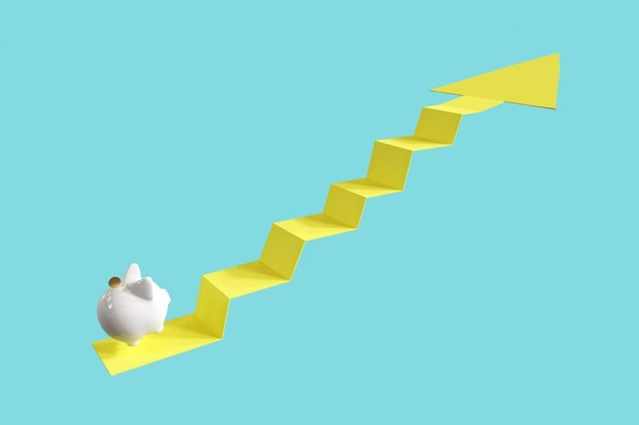 White Piggy Bank with coin Jump on Arrow Up. on Blue background. Minimal idea business concept. 3D rendering.