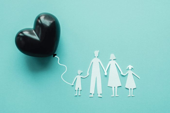 Family paper cut out and black heart balloon, causes and effects impact on child development and behavior of dysfunctional family, divorce parent, broken home concept, children mental illness health
