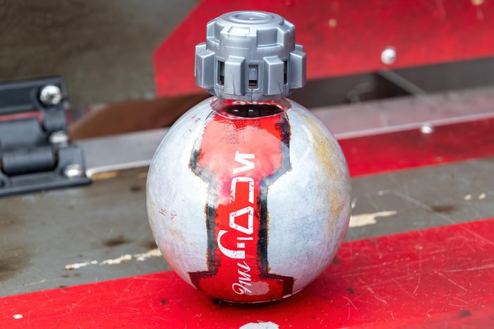 """ORLANDO, USA - SEPTEMBER 19, 2019: Star Wars themed Diet Coke bottle made to look like a thermal detonator. The writing is called Aurebesh and translates to """"DIET COKE"""""""