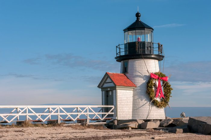 Brand Point Lighthouse, located on Nantucket Island in Massachusetts, decorated for the holidays with a Christmas wreath and crossed oars.