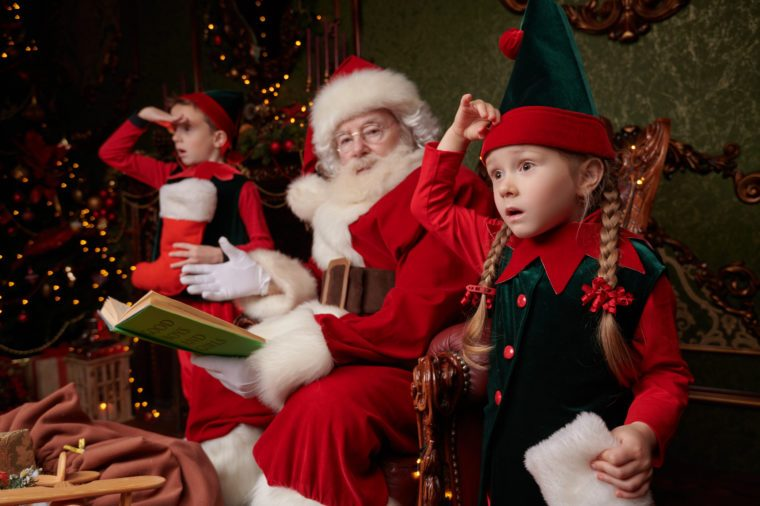 Little elves help Santa Claus prepare Christmas presents at his home. Merry Christmas and Happy New Year!