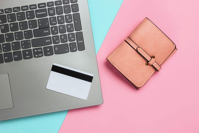 laptop and credit card flat lay