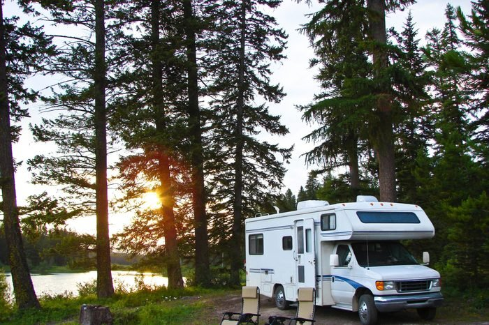 RV and chairs at secluded campsite at sunset