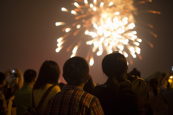 Fireworks with silhouettes of people in a holiday events,Shanghai