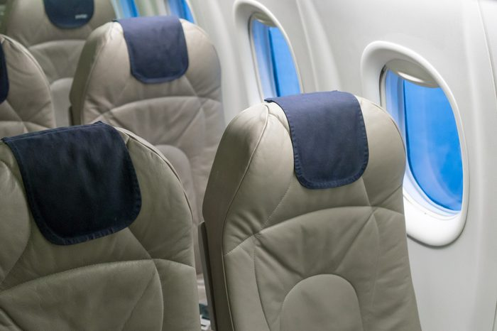 Close-up of window and seats of an airplane