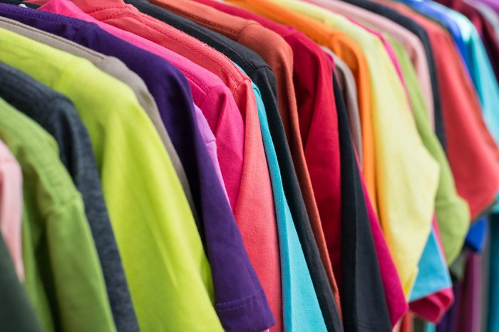row of color T-SHIRT hanging on clothes hanger, concept of rainbow in nature