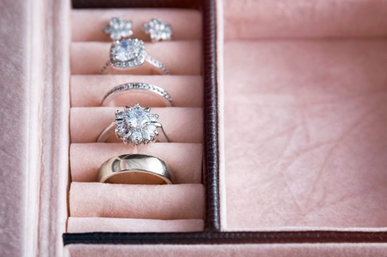Jewelry box with white gold and silver rings. Collection of luxury jewelry