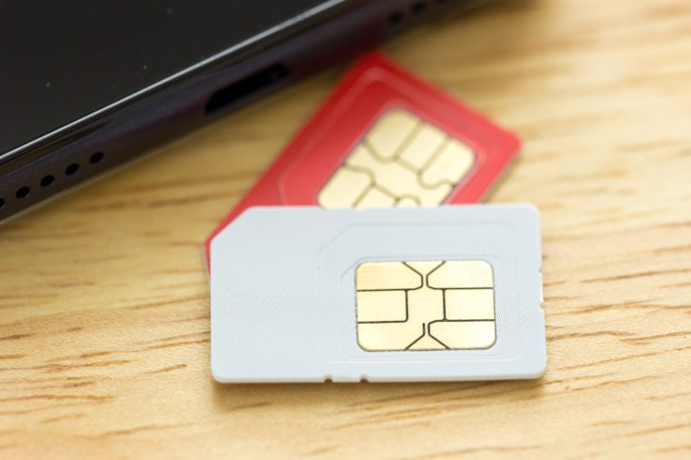 nano sim card extract from sim card adaptor on wood background