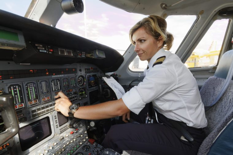 Italy, female pilot in an airplane's cockpit