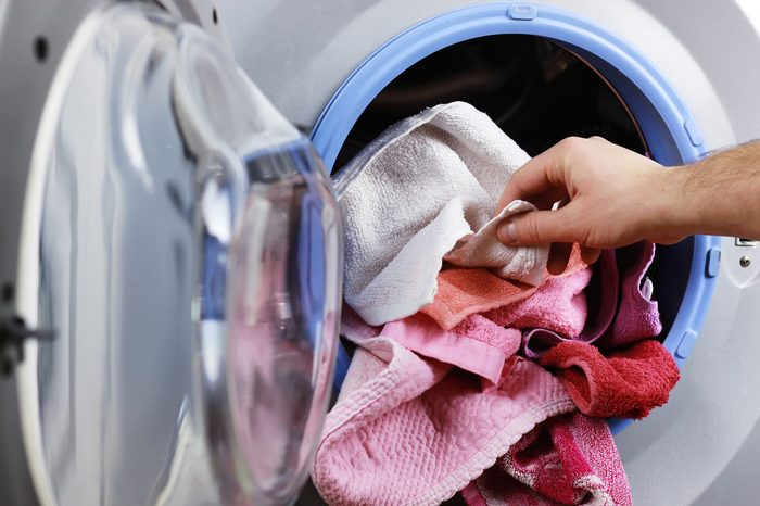 put cloth in washer