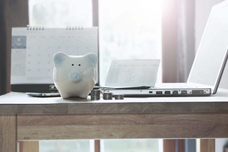 Pig piggy bank, coins, bank book, notebook, desktop concept of saving money.