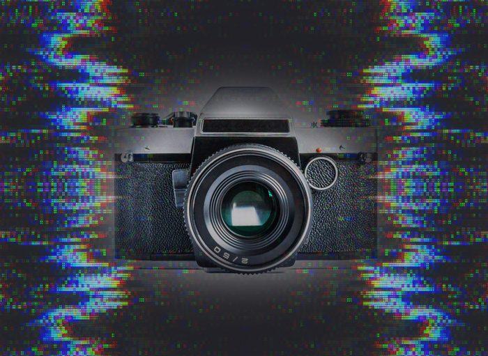 Retro film photo camera isolated on white background; Shutterstock ID 528068158