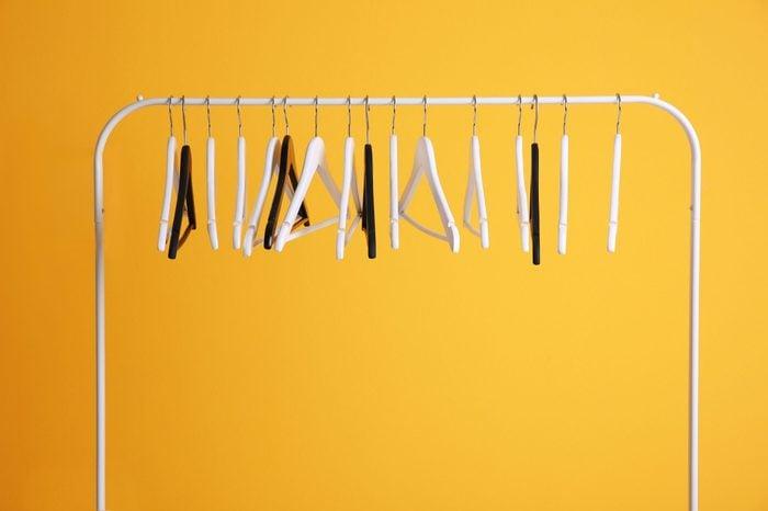 Modern hangers on yellow wall background