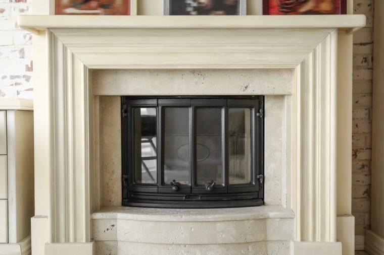 Modern beige fireplace in room