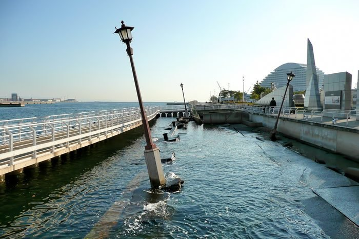 A view of the Kobe Earthquake Memorial Park, where a piece of the harbor is being left untouched in its wrecked state.