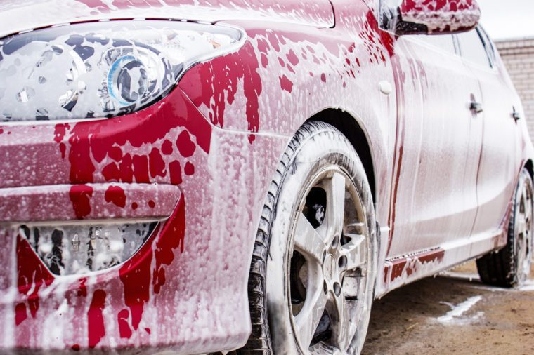 the image car washing, red car in foam