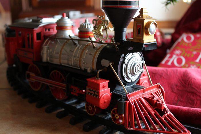 Toy Train Underneath a Christmas Tree