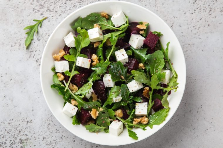 beetroot, arugula, feta cheese and walnut salad, top view