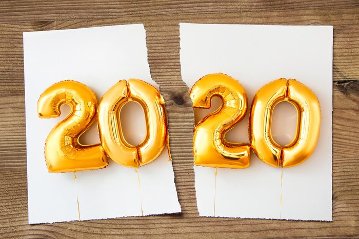 "image of a ripped image of ""2020"" written in balloons"