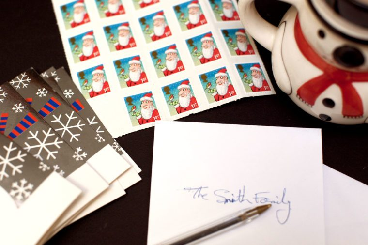 christmas card envelope and stamps