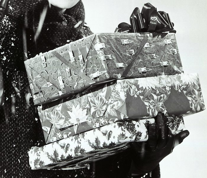 Mandatory Credit: Photo by Ewing Galloway/Uig/Shutterstock (3799832a) MODEL RELEASED, Woman with gifts in snow VARIOUS