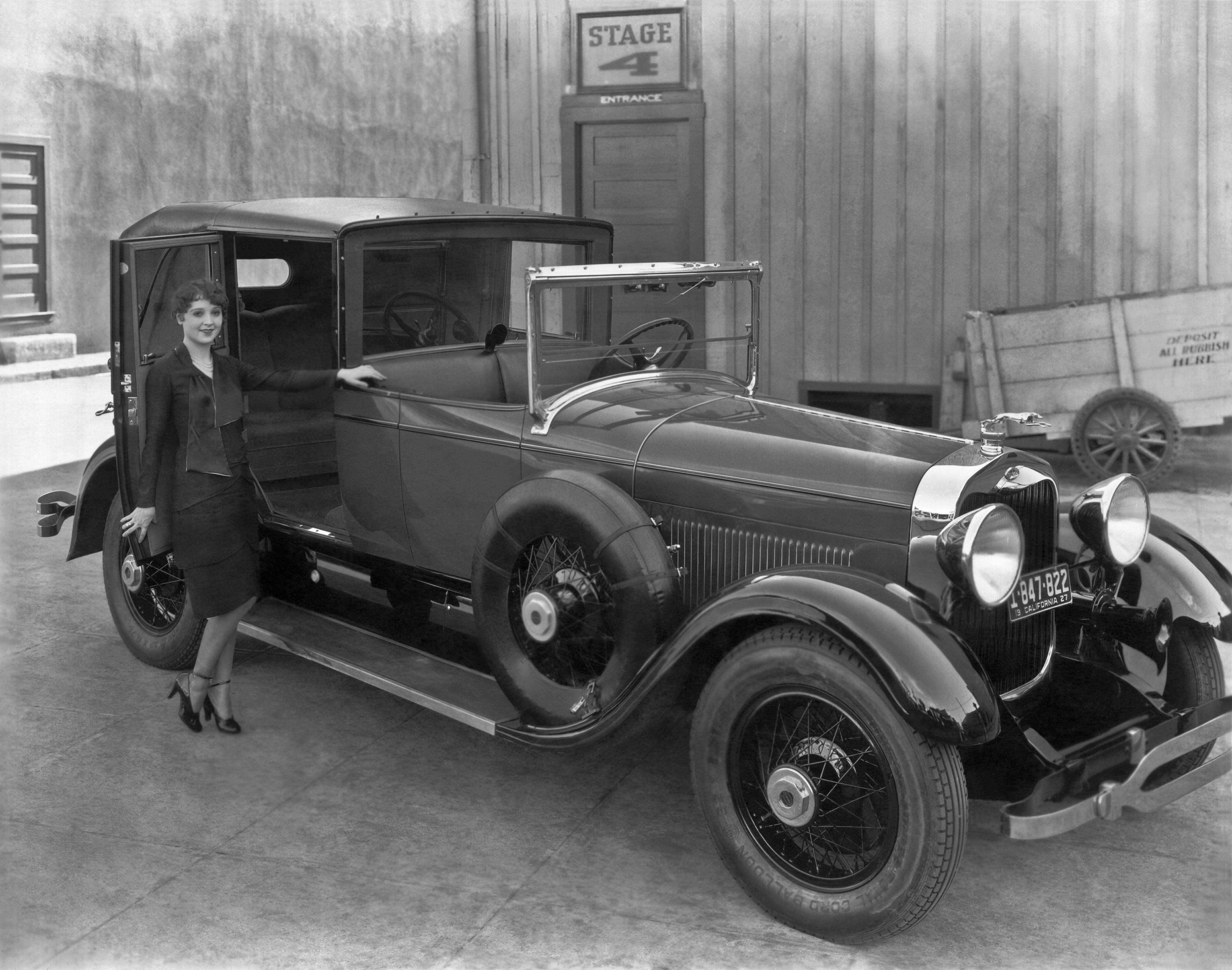 Mandatory Credit: Photo by Underwood Archives/Shutterstock (4437299a) Hollywood, California: 1927. A young woman prepares to enter the rear compartment of a 1927 Lincoln L-series towncar. VARIOUS