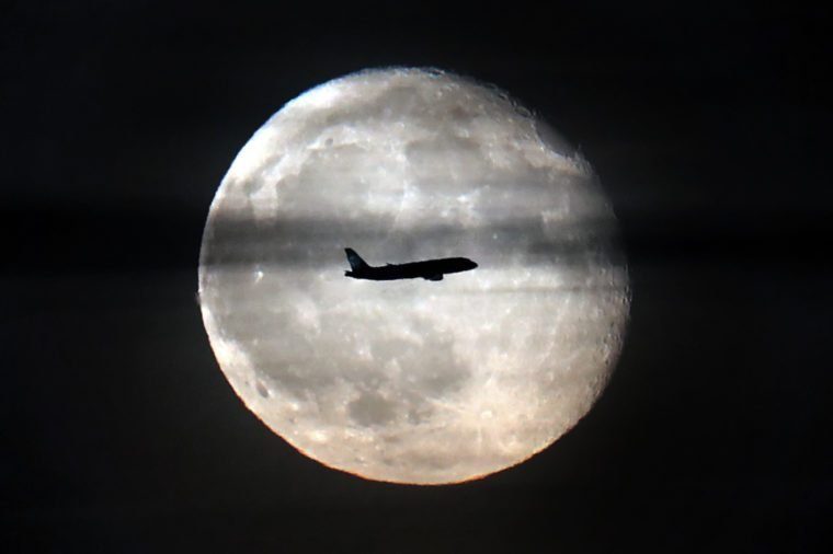 A commercial jet passes in front of the moon over Moscow, Russia, 14 November 2019. The full moon peaked 12 November 2019 and will wane until the new moon is reached on 26 November 2019. 14 Nov 2019
