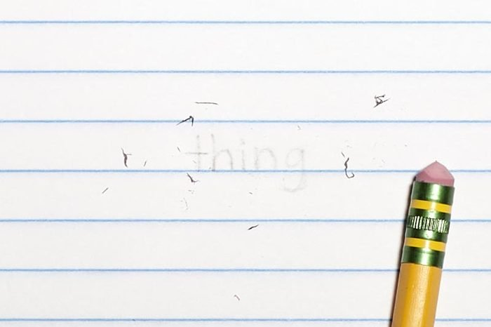 """erased text """"thing"""" with eraser shavings on loose leaf paper"""