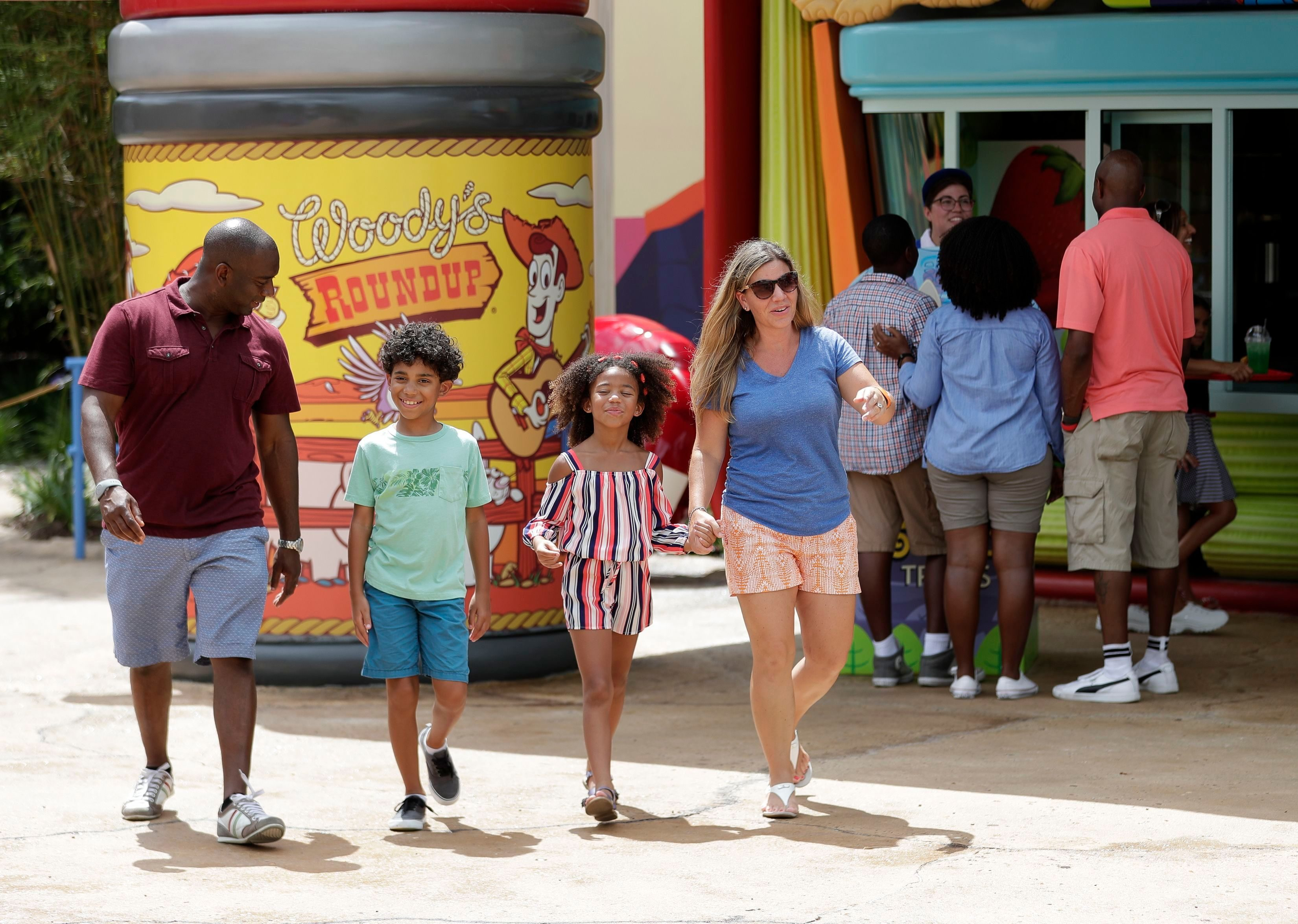 Mandatory Credit: Photo by John Raoux/AP/Shutterstock (9730910i) Park guests walk to Woody's Lunchbox, a restaurant, at Toy Story Land in Disney's Hollywood Studios at Walt Disney World in Lake Buena Vista, Fla Toy Story Land Preview, Lake Buena Vista, USA - 23 Jun 2018