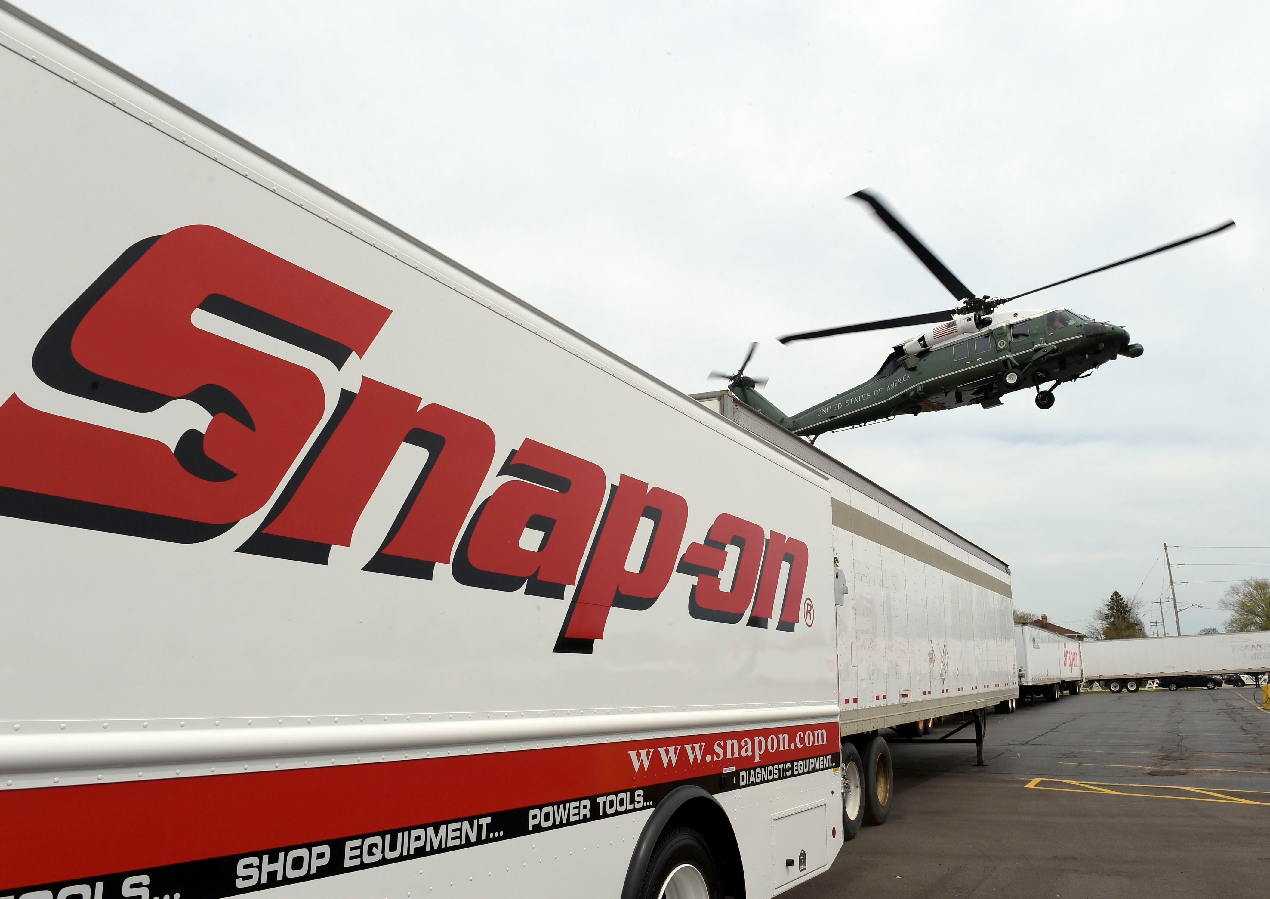 Mandatory Credit: Photo by AP/Shutterstock (8617725a) Marine One, with President Donald Trump aboard, arrives at tool manufacturer Snap-on Inc., in Kenosha, Wis.,. Trump visited the headquarters of tool manufacturer Snap-on Inc., and will later sign a an executive order that seeks to make changes to a visa program that brings in high-skilled workers Trump, Kenosha, USA - 18 Apr 2017