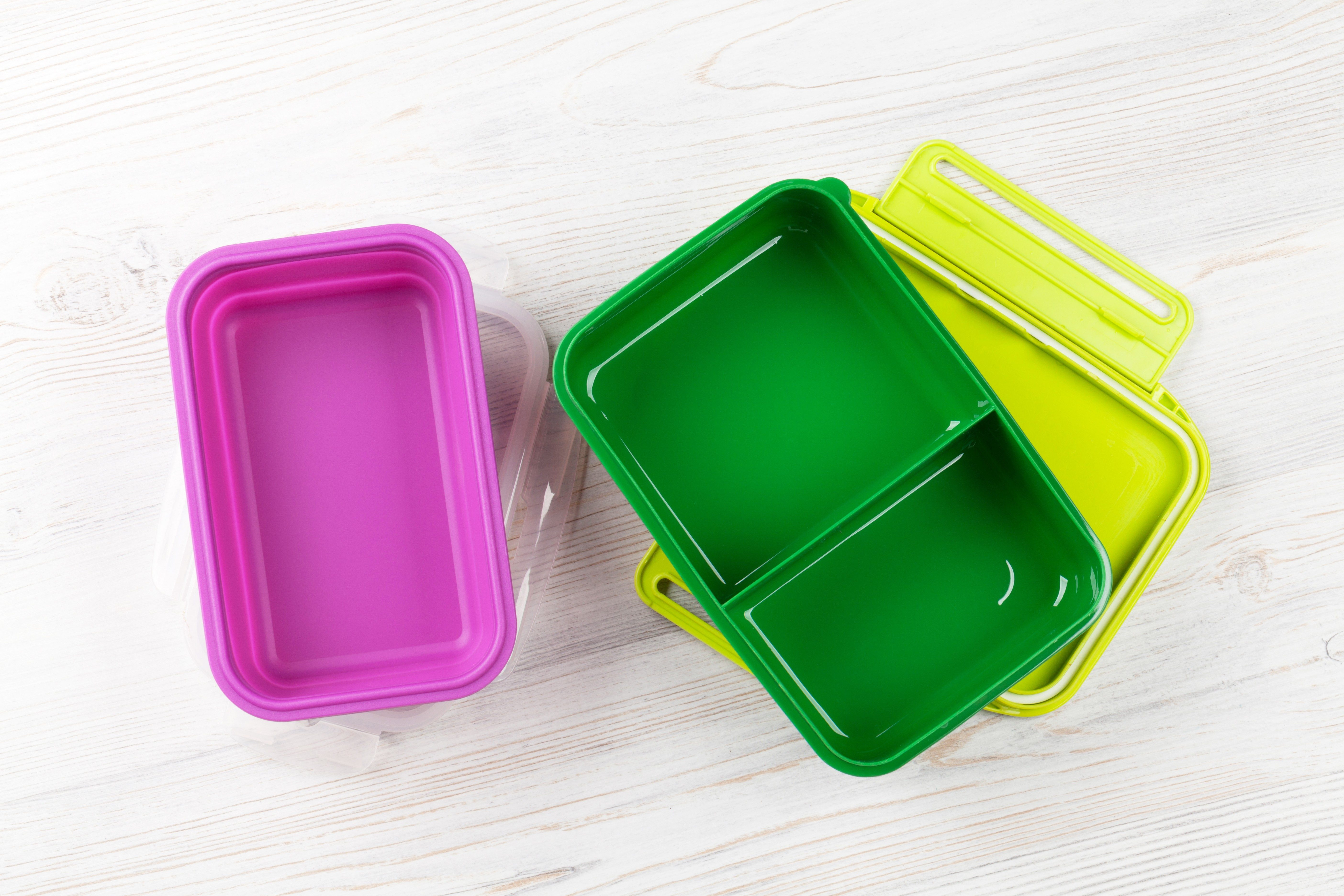 Empty lunch boxes on wooden table. Top view