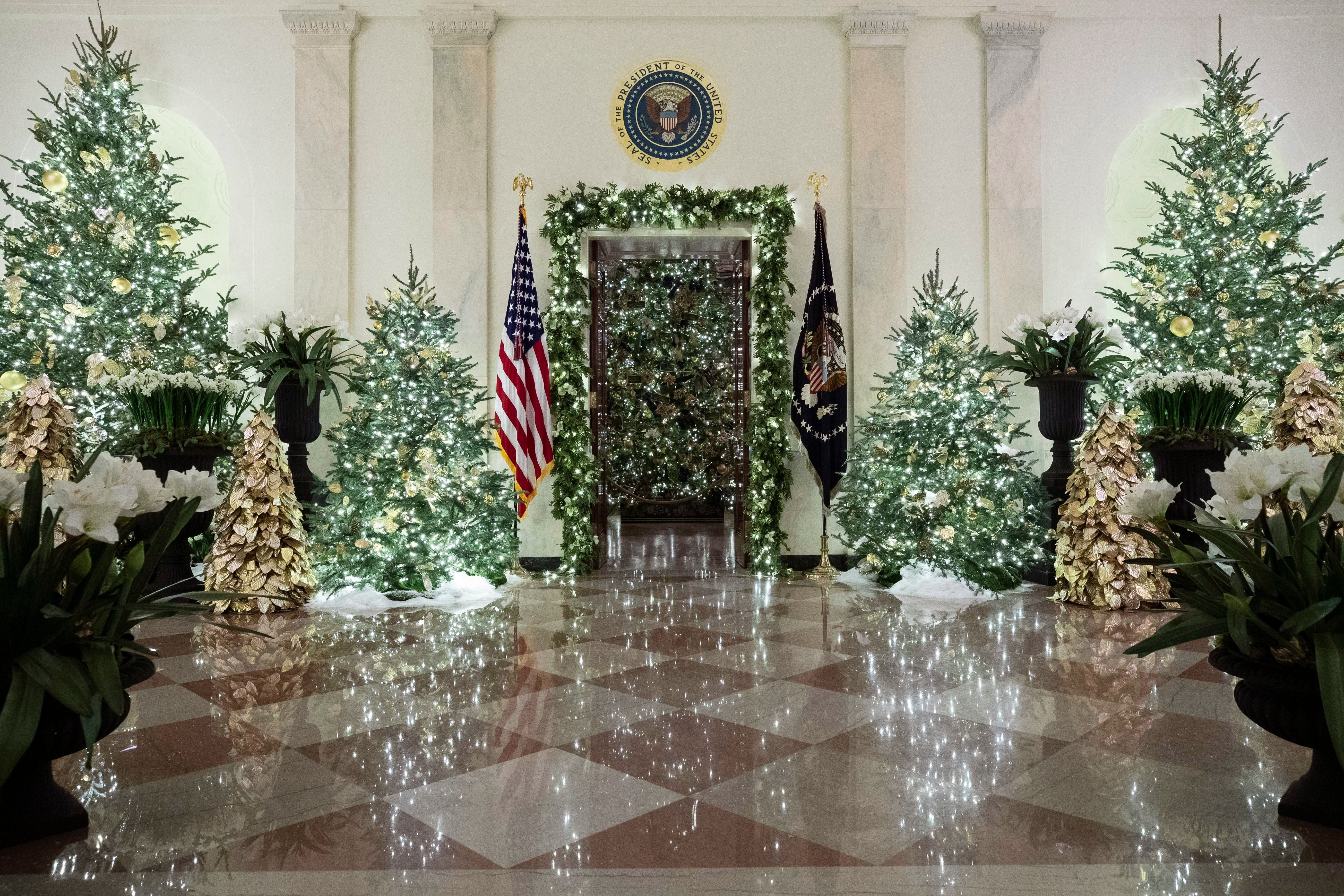Mandatory Credit: Photo by Alex Brandon/AP/Shutterstock (10489702p) The official White House Christmas tree is decorated in the Blue Room seen through the Cross Hall, during the 2019 Christmas preview at the White House, in Washington White House Christmas, Washington, USA - 02 Dec 2019