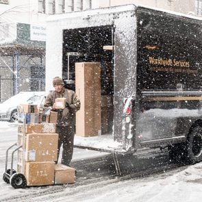 Mandatory Credit: Photo by Michael Brochstein/Sopa Images/Shutterstock (9472885d) Unloading a UPS (United Parcel Service) truck on West 72nd Street in a snow storm in New York City. Winter Storm Toby, New York, USA - 21 Mar 2018