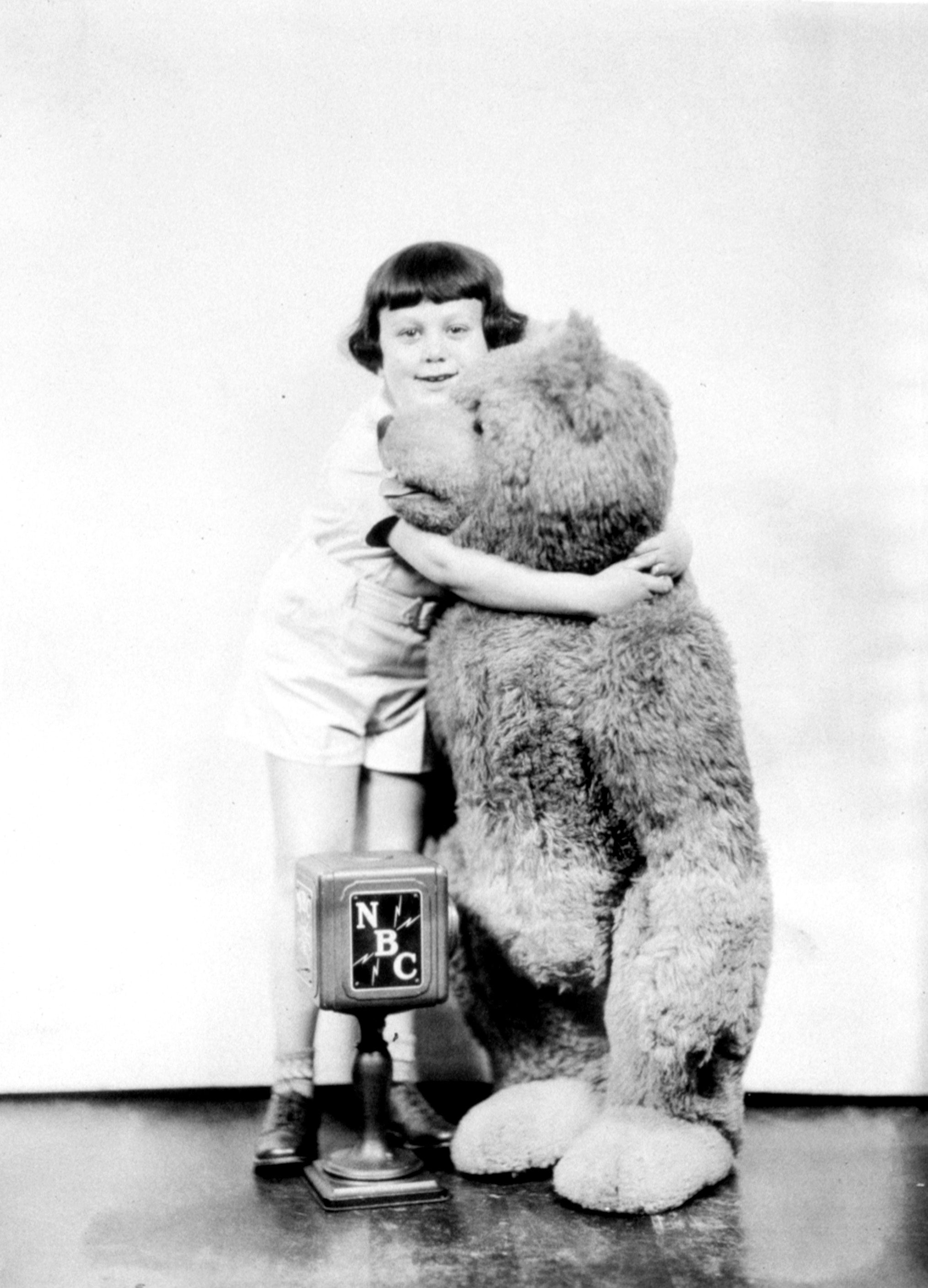 Mandatory Credit: Photo by Everett/Shutterstock (10284262a) Christopher Robin Milne with the original Winnie the Pooh, 1920s Historical Collection