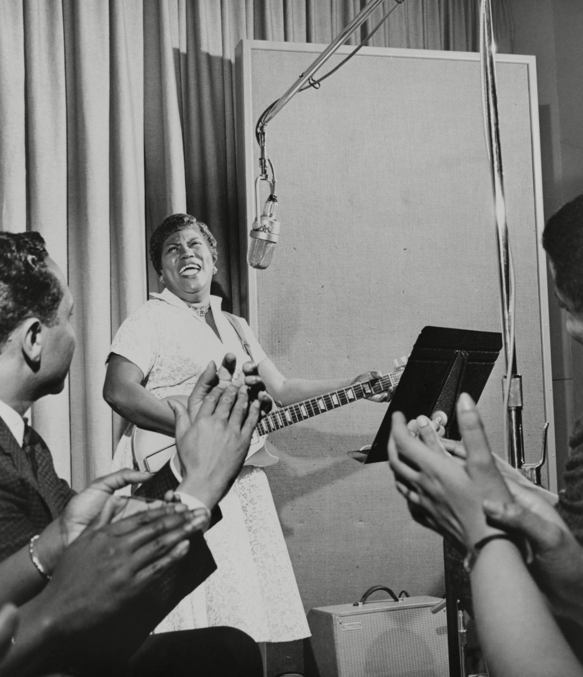 Photo by Everett/Shutterstock (10293662a) Sister Rosetta Tharpe, Godmother of Rock n Roll, performing in an MGM studio in 1961. Historical Collection