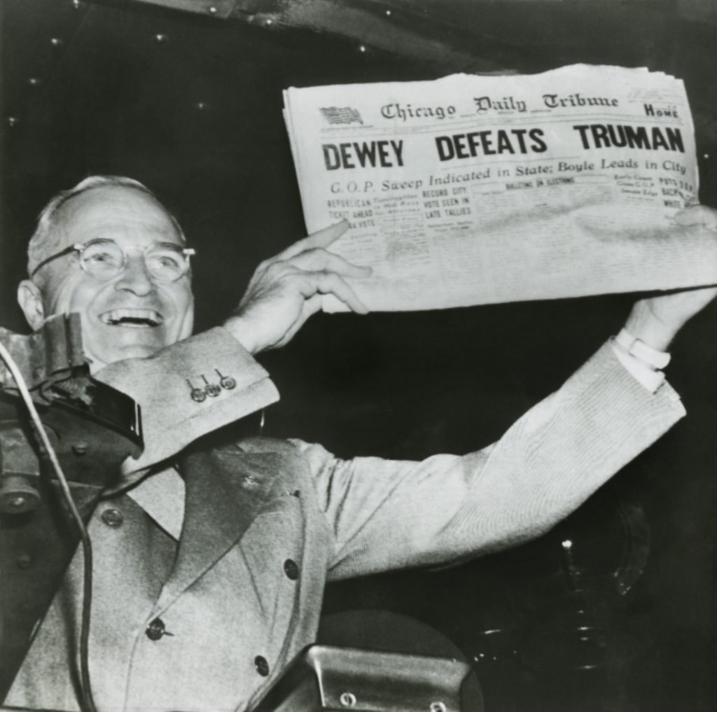 Harry S. Truman, president-elect, holds up edition of Chicago Daily Tribune with headline Dewey Defeats Truman. The Republican newspaper followed the public polls predictions that Truman would be defeated by Dewey. Instead, Truman won with electoral votes to spare and a 49.6 % of the popular vote to Deweys 45.1 %. Nov. 3, 1948. - Historical Collection