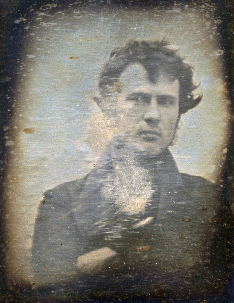 Robert Cornelius (1809-1893) was an American pioneer of photography. This self-portrait was taken outside of his family's store. It is the first known image of a human in American history.