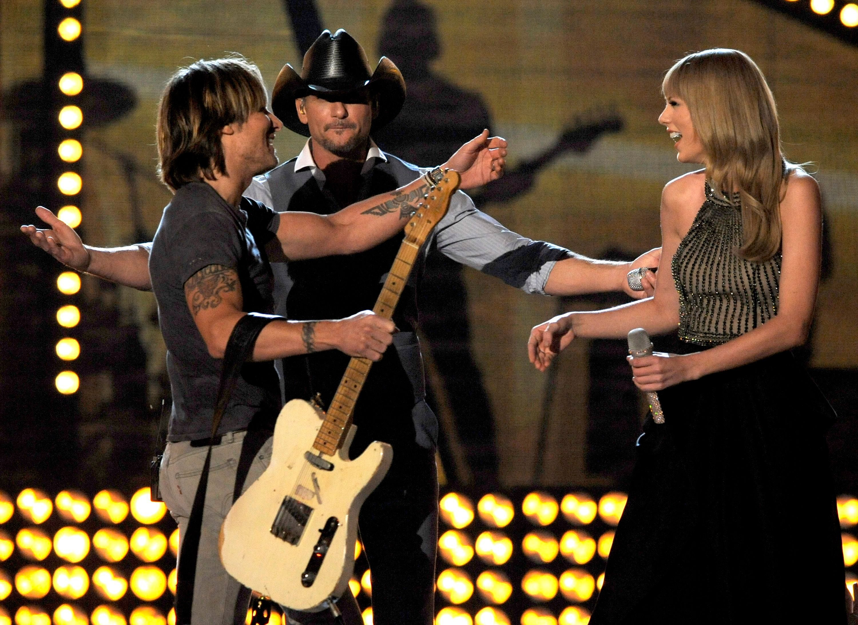 Mandatory Credit: Photo by Chris Pizzello/Invision/AP/Shutterstock (9192379b) From left, Keith Urban, Tim McGraw and Taylor Swift perform at the 48th Annual Academy of Country Music Awards at the MGM Grand Garden Arena in Las Vegas on 48th Annual Academy of Country Music Awards - Show, Las Vegas, USA - 7 Apr 2013