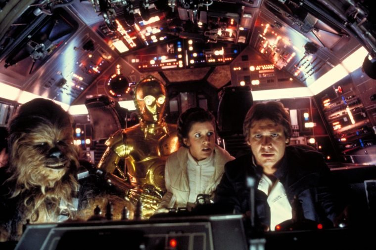 Peter Mayhew, Anthony Daniels, Carrie Fisher, Harrison Ford in the cockpit of the Millenium Falcon