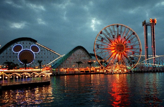 Mandatory Credit: Photo by Damian Dovorganes/AP/Shutterstock (6476118a) CALIFORNIA ADVENTURE Midway-type rides, one sporting the outline of Disney's famous character, Mickey Mouse, are seen, at California Adventure in Anaheim, Calif., the latest addition to the Walt Disney theme park family. The park, adjacent to Disneyland, opens Feb. 8 and will feature miniature versions of the best the state has to offer, from historic landmarks to its natural terrain, wrapped around rides, stores and restaurants TRAVEL NEW DISNEY PARK, ANAHEIM, USA