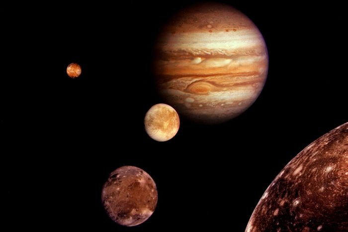 Jupiter and Its Four Planet- Size Moons - Collage of Images From Voyager I Taken in March 1979 Europa (centre) Ganymede and Callisto (lower Right) and Io (upper Left)