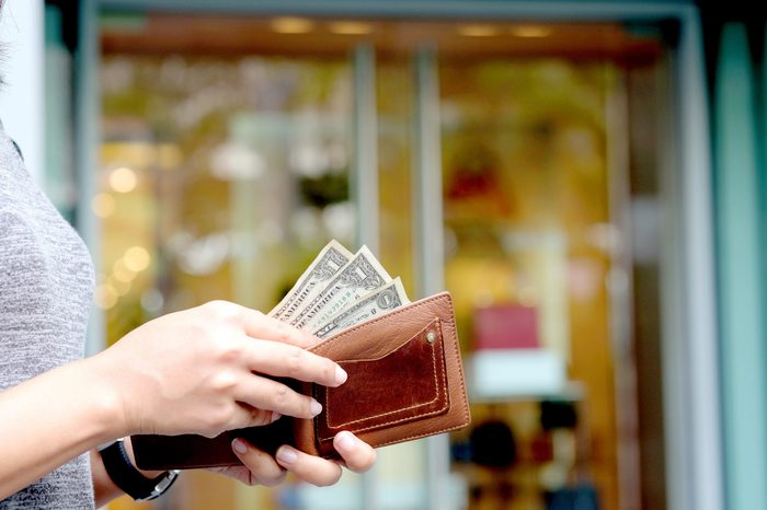 Women hold money in wallets pay shopping .background Bag and Fashion Shop