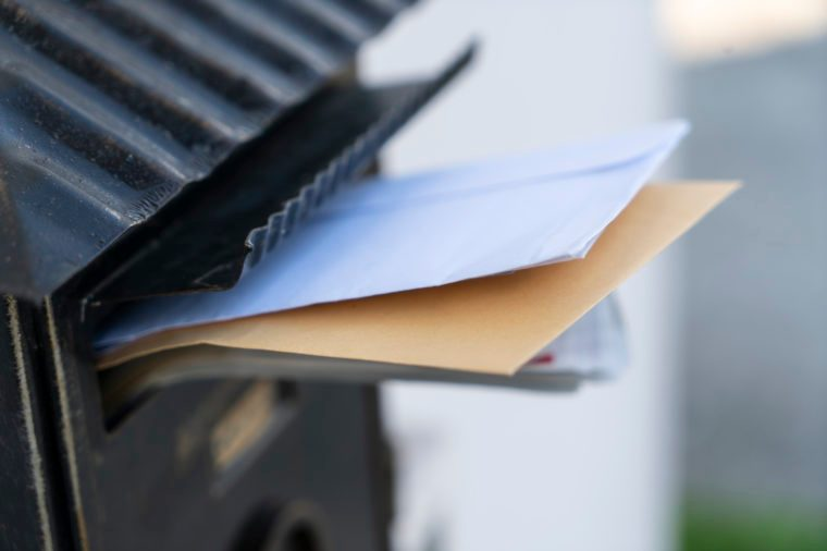 mail sticking out of a letterbox